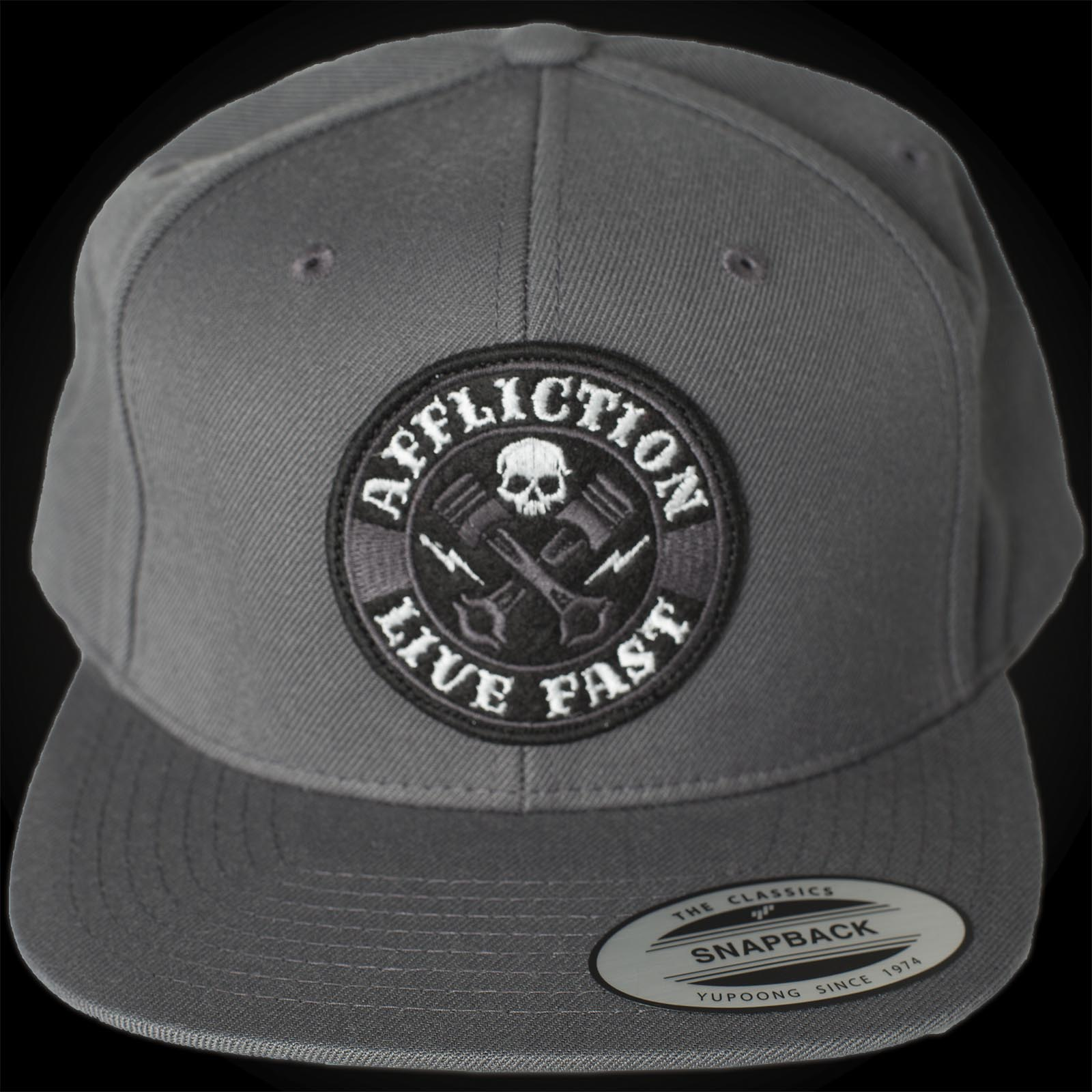 2a302d6edf3 Affliction Cross Pistons Cap with an embroidered patch